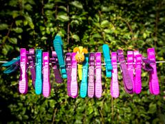 Colorful character plastic pegs on a line Stock Photos