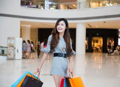 Stock Photo of a young woman shopping in mall