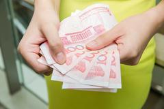 shopping woman with money bills - stock photo