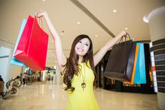 young woman shopping in mall - stock photo