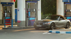 Blond in rich car, gas station service, fueling gasoline petrol Stock Footage
