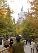 Tourists by neuschwanstein castle at fall bavaria germany Stock Photos