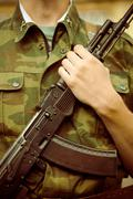 Soldier with AK-47 assault rifle Stock Photos