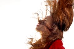 Young girl with hair in motion Stock Photos