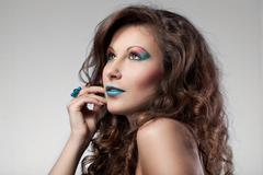 Portrait of woman with color make-up Stock Photos