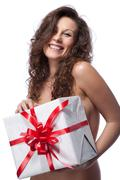 portrait of a nude smiling woman with gift isolated on white - stock photo