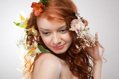 Portrait of beautiful naked woman with spring flowers Stock Photos