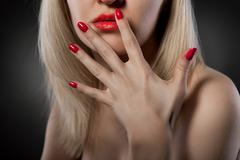 woman with red nails - stock photo