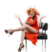 sexy redhead woman in red dress, screaming isolated on white - stock photo