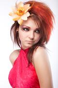 portrait of beautiful woman with spring flower in hair on white - stock photo