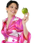 young beautiful happy woman holding green apple on white - stock photo