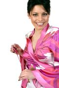 Attractive smiling girl in kimono undress isolated Stock Photos