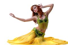 Young attractive belly-dancer woman isolated on white - stock photo