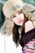 winter portrait of young woman in fur hat - stock photo
