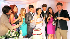 Group people open bottle of champagne at wedding - stock footage