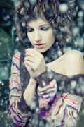 young woman freeze under falling snow - stock photo