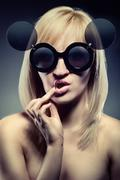 attractive woman with funny glasses - stock photo