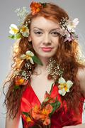 portrait of beautiful woman with spring flowers - stock photo