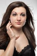 portrait of attractive young woman on white - stock photo