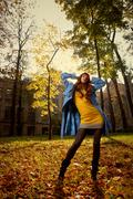 Stock Photo of woman in blue jaket posing in autumn park