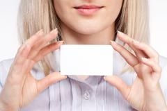 Woman hand holding empty visiting card Stock Photos