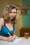 young woman writing a notice - stock photo