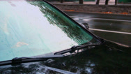 Stock Video Footage of Raining on car front glass, windscreen wipers work, day rain, click for HD
