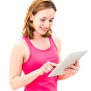 young woman using tablet pc - stock photo