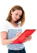 young smiling woman reading folders - stock photo