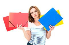 Unhappy woman with folders Stock Photos