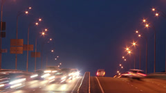 Timelapse of bridge highway traffic, dusk cars drive lights on, click for HD - stock footage
