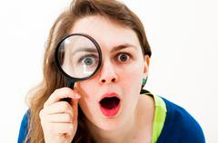 Stock Photo of woman with magnifying glass
