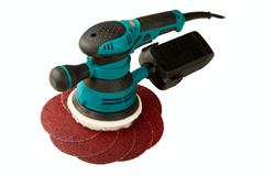 grinding car and abrasive disks - stock photo