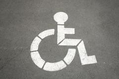 parking sign for handicapped painted on the street - stock photo