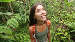 Hiking woman happy exploring forest looking around Stock Footage