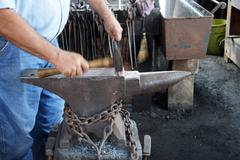 Blacksmith hammers nails Stock Photos