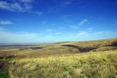 Blue sky and rolling hills Stock Photos