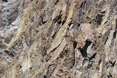 yksityiskohta, maankuoren vääntymisen tulivuoren rhyolite kiviä - stock photo