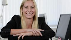 Laughing young businesswoman - stock footage