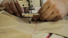 Sewing machine close up in a dressmaker's factory Stock Footage
