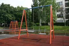 playground children's child chain swings on summer kids playground - stock photo