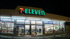 7-Eleven storefront drive up Stock Footage