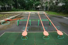 playground children's child seesaws teeter on summer kids playground - stock photo