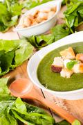 creamy soup with dried crusts - stock photo