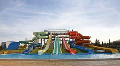 Colourful aquapark slides - stock photo