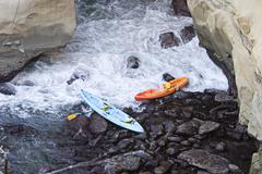 Two abandoned kayaks Stock Photos