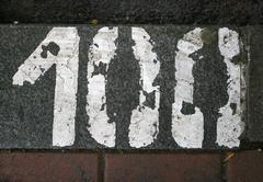 parking number painted in white on asphalt 100 - stock photo