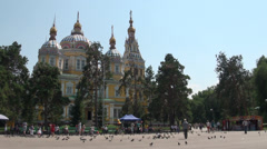 Almaty, Orthodox Russian Cathedral, park, kids, pigeons Stock Footage