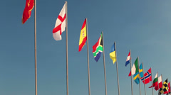 All countries national flags waving on flagpole on blue sky Stock Footage