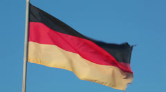 Germany national flag waving on flagpole on blue sky background Stock Footage